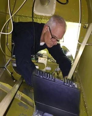 Brian Lloyd WB6RQN installing a Micom 3 ALE HF Radio in Mooney M20K 231 airplane